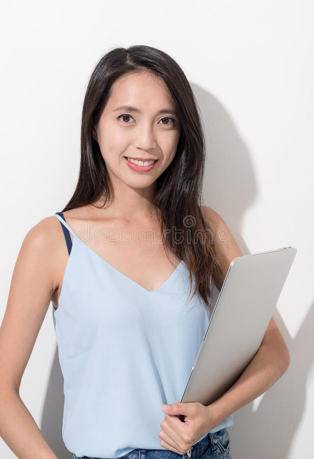 Woman holding laptop computer. Asian young woman royalty free stock photos