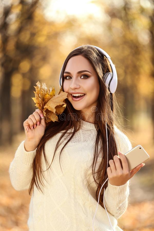 Woman holding leafs and smartphone stock photos