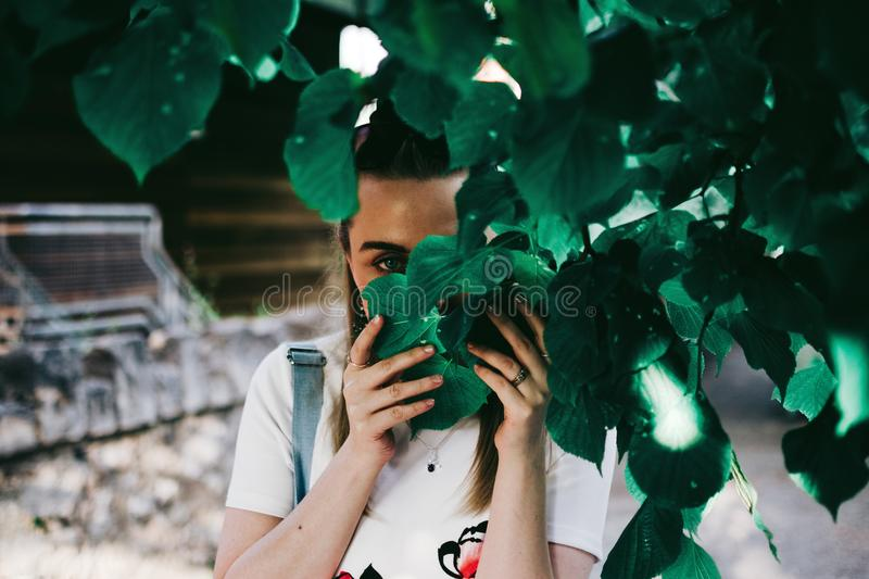 Woman Holding Leaves Covering Her Face royalty free stock photos