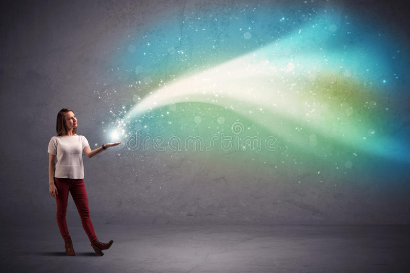 Woman holding light. Caucasian woman holding blue, white, green coloured stria of light stock photography