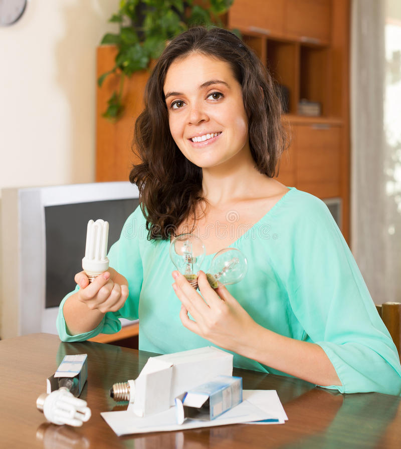 Woman holding lightbulbs royalty free stock images