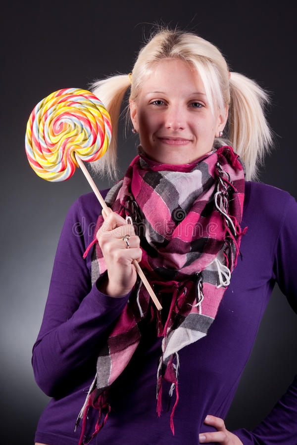 Download Woman holding lollypop stock photo. Image of caucasian - 18913572