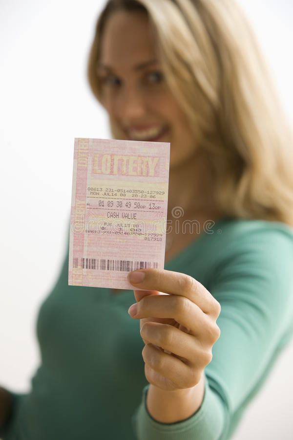 Woman Holding Lottery Ticket stock photography