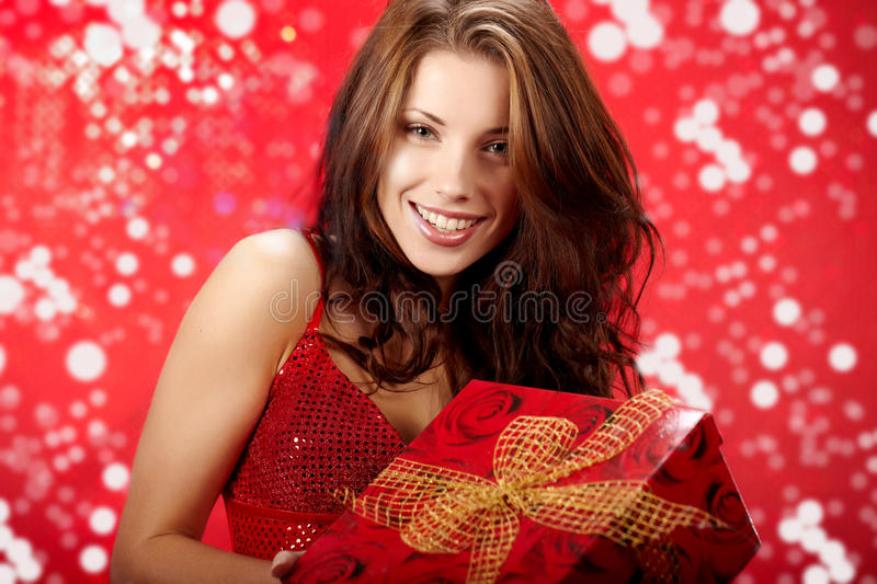 Woman holding a magic gift in packing