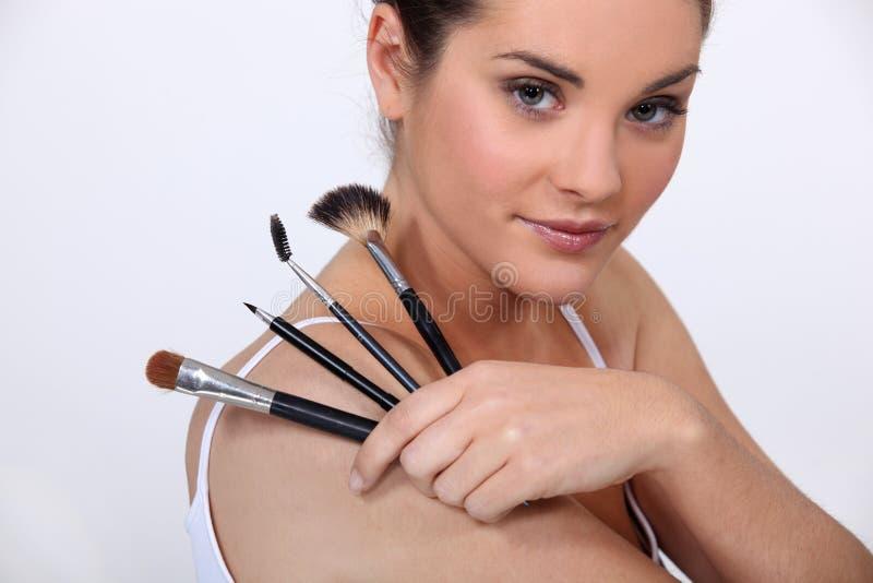 Woman holding make up stock photos