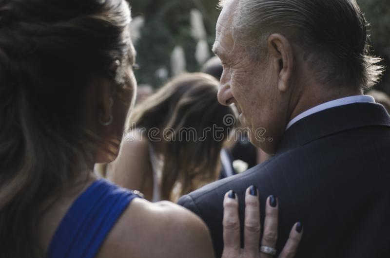 Woman Holding A Man On The Back royalty free stock image