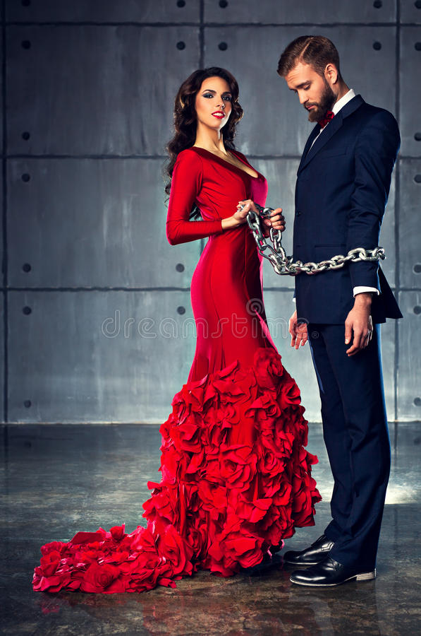 Free Woman Holding Man On Heavy Chain Stock Images - 56077434