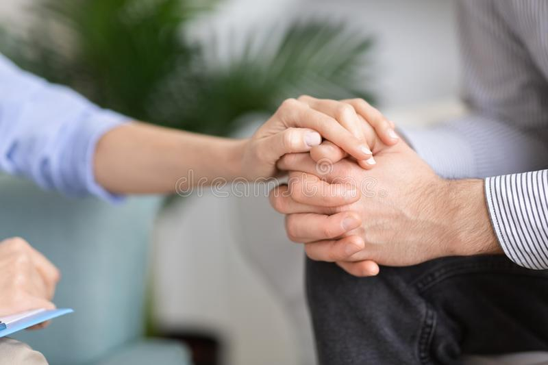 Woman holding man`s hand in support gesture royalty free stock photography