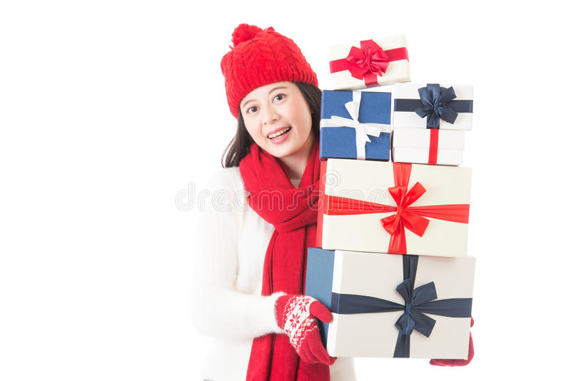 Woman holding many Christmas gifts in her arms stock photos