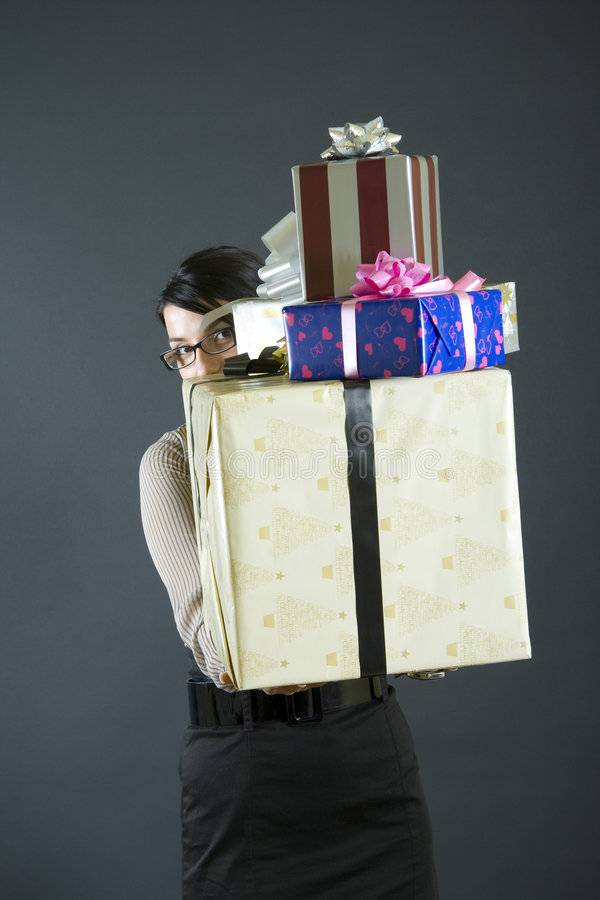 Woman holding many presents royalty free stock images