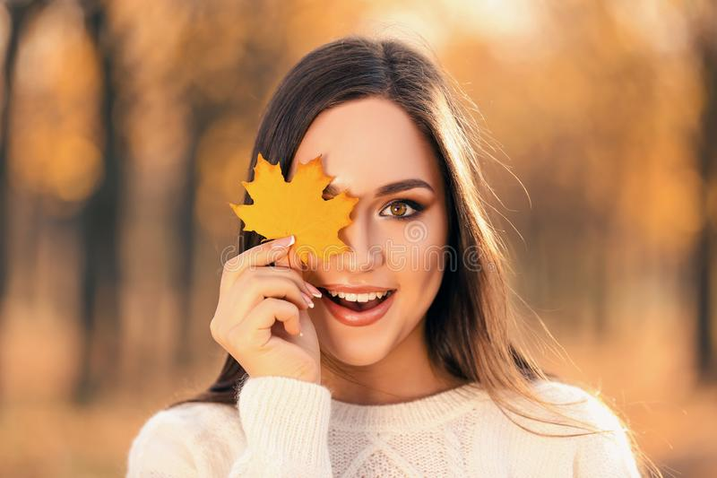 Woman holding maple leaf royalty free stock photos