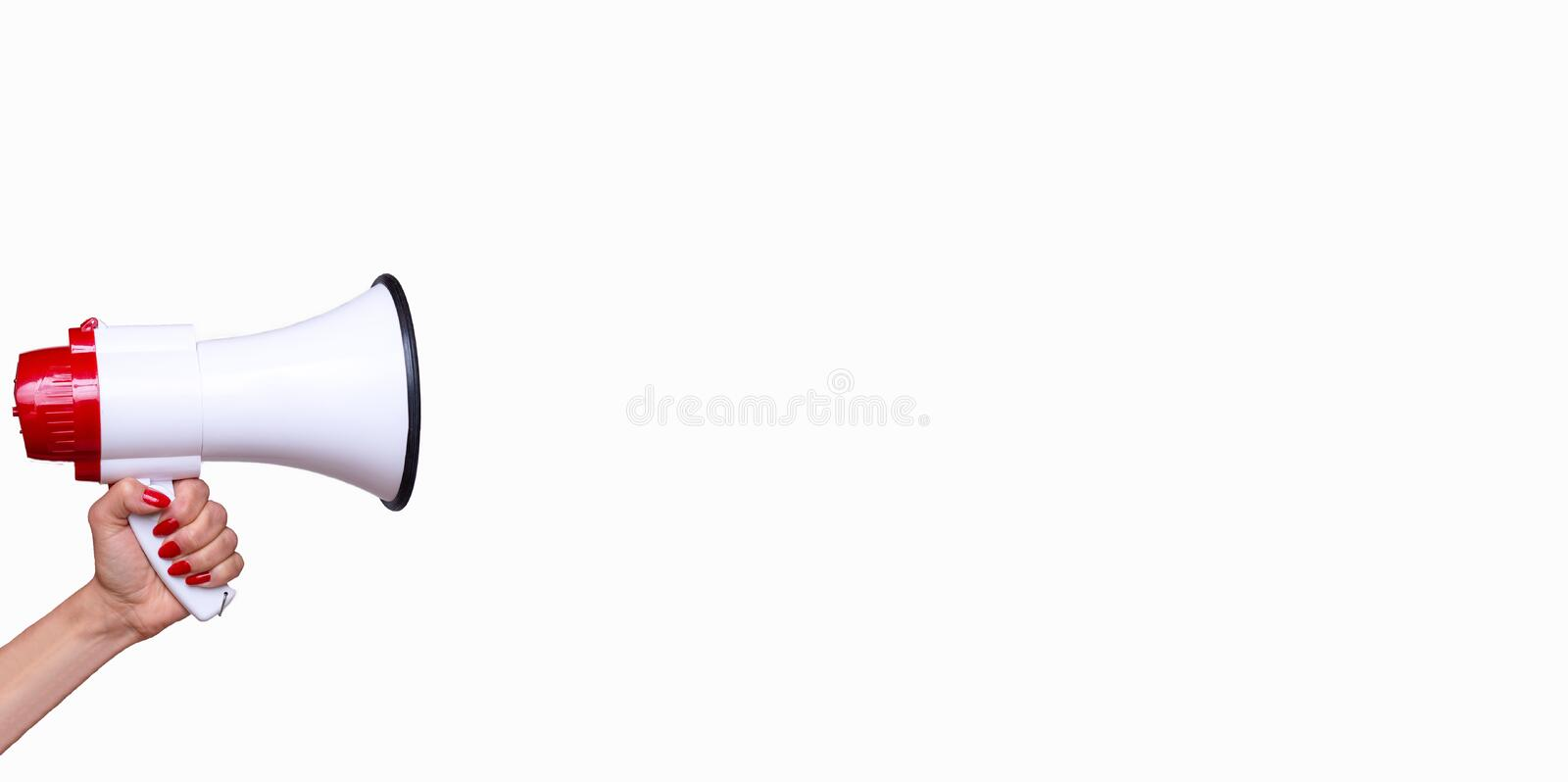 Woman holding a megaphone. Woman holding a bullhorn or megaphone isolated on a white background with copy space in a conceptual image of vocal communication royalty free stock image