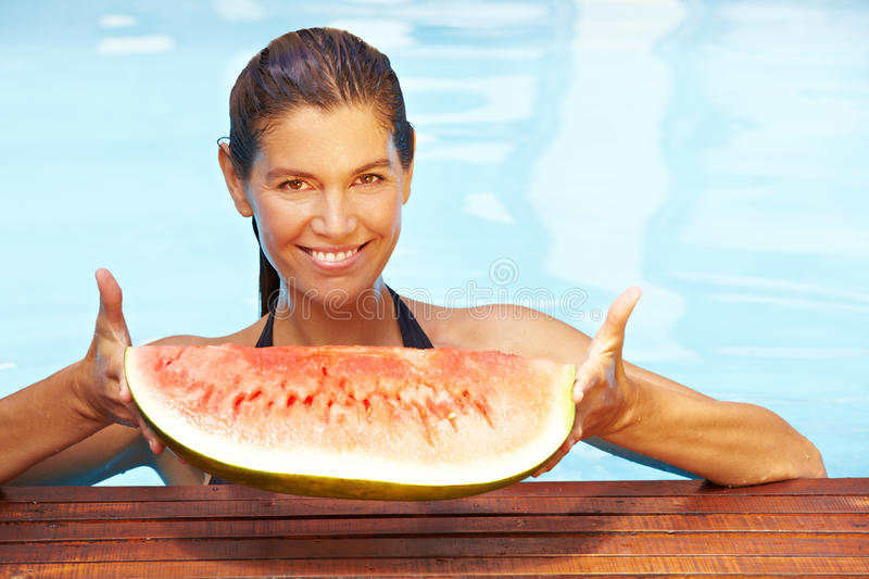 Download Woman Holding Melon In Pool Stock Image - Image of snack, bath: 24820997