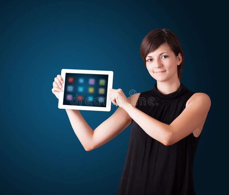 Download Woman Holding Modern Tablet With Colorful Icons Royalty Free Stock Photos - Image: 28655918