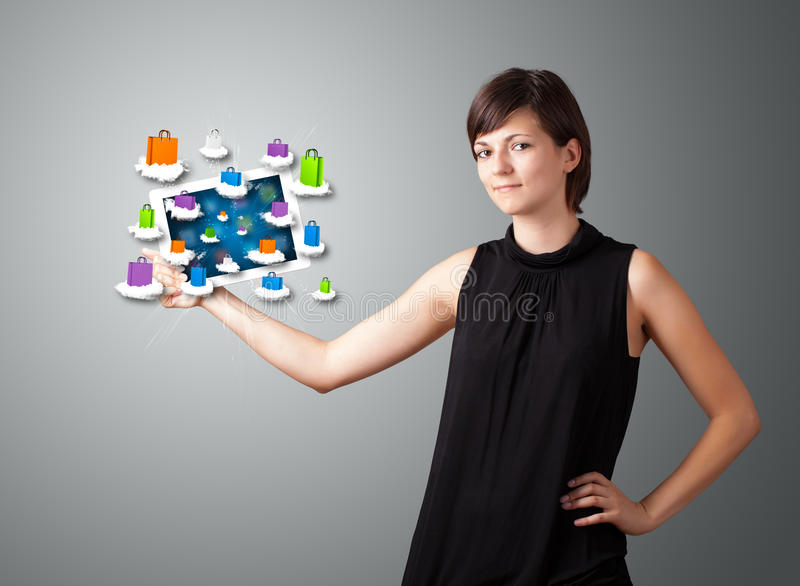 Download Woman Holding Modern Tablet With Colorful Shopping Bags On Cloud Stock Image - Image: 30743971