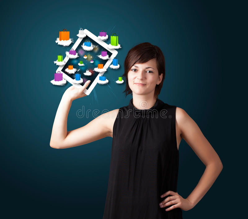 Download Woman Holding Modern Tablet With Colorful Shopping Bags On Cloud Stock Photo - Image of hand, modern: 32702966