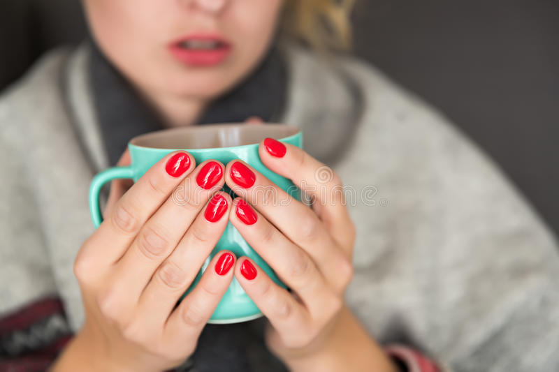 Woman holding mug stock images