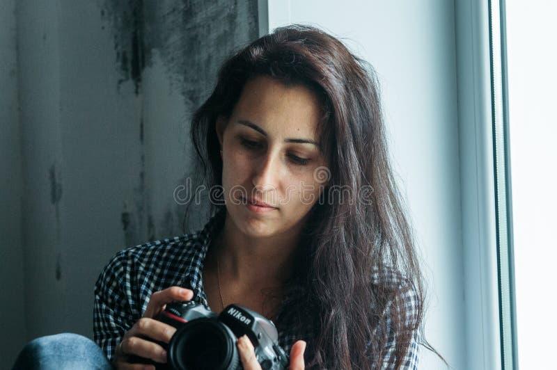 Woman Holding Nikon Dslr Camera stock image