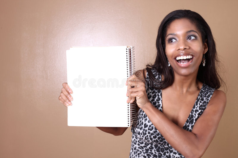 Woman holding a notebook