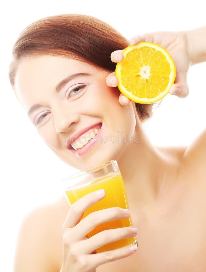Free Woman Holding Orange And Orange Juice Stock Images - 35109604