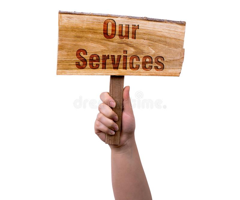 Our services wooden sign. A woman holding our services wooden sign isolated on white background stock images