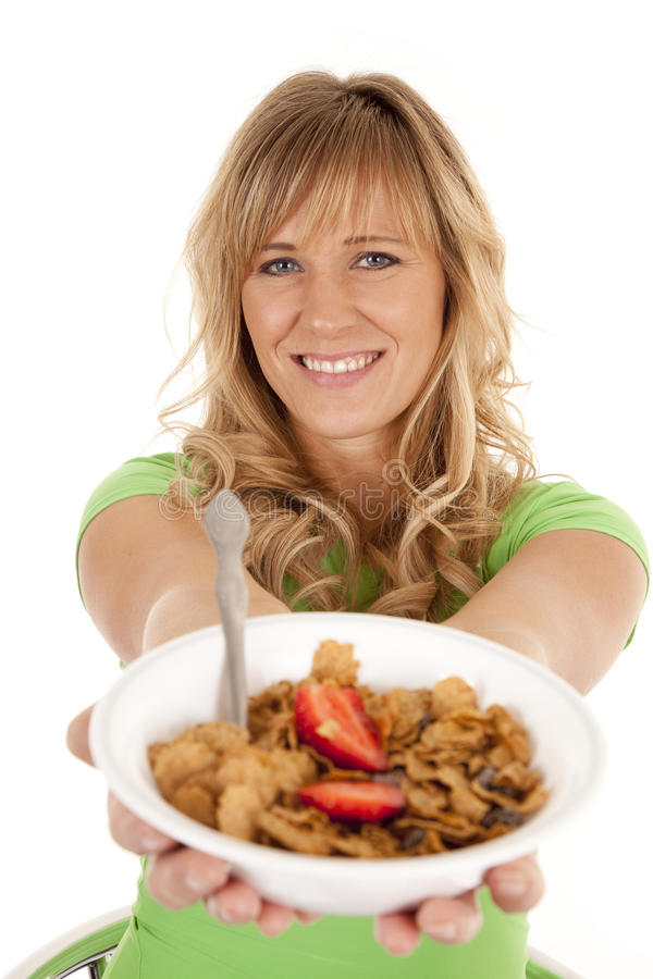Download Woman Holding Out Cereal Smile Stock Image - Image: 21632327