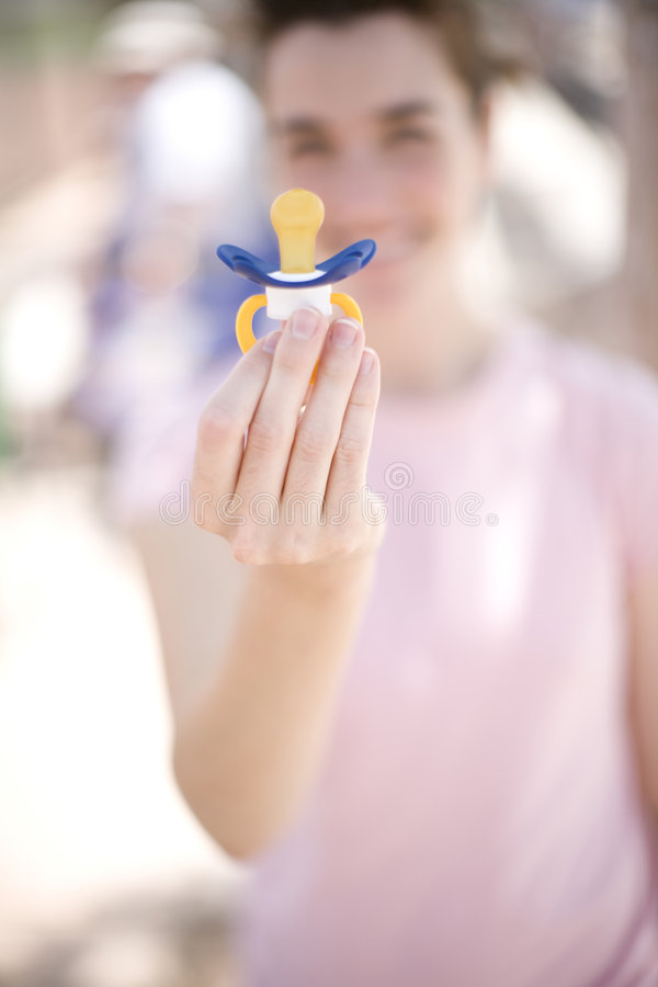 Free Woman Holding Pacifier Stock Images - 5193274