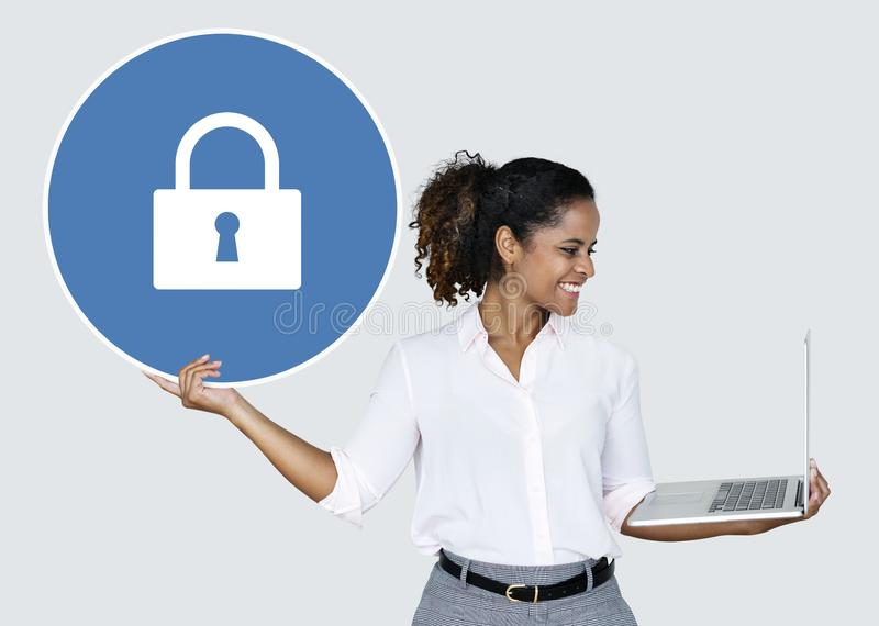 Woman holding a padlock and a laptop stock image