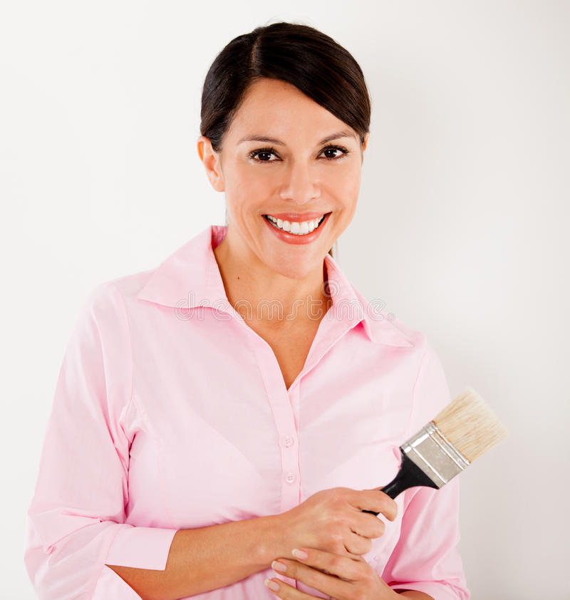 Download Woman Holding A Paint Brush Stock Photo - Image: 26365956