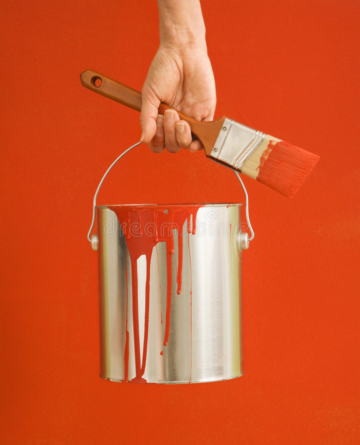 Download Woman holding paint can. stock photo. Image of 070925m0583 - 3533294