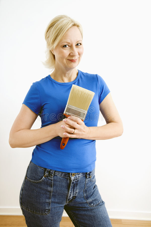 Download Woman holding paintbrush. stock photo. Image of female - 6153512