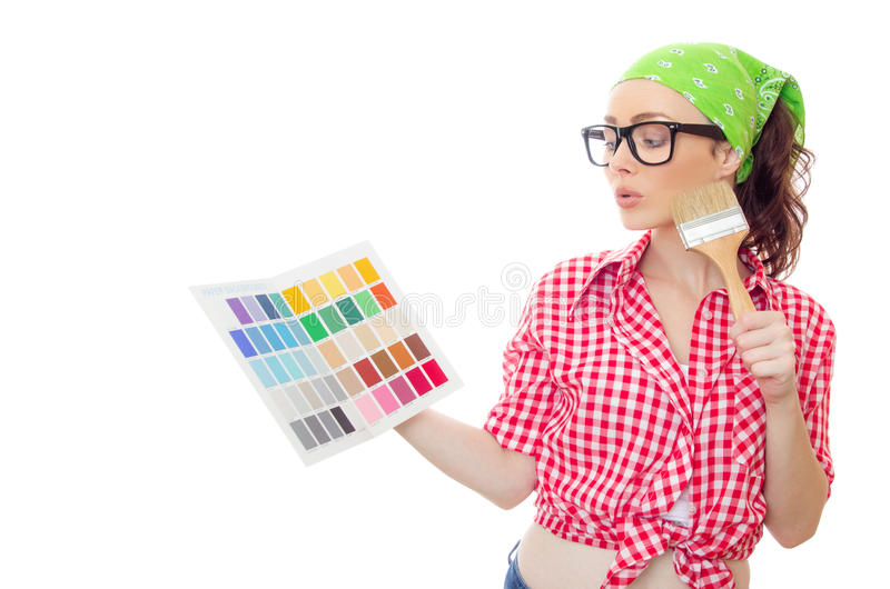 Woman holding paintbrush and color samples for selection royalty free stock image