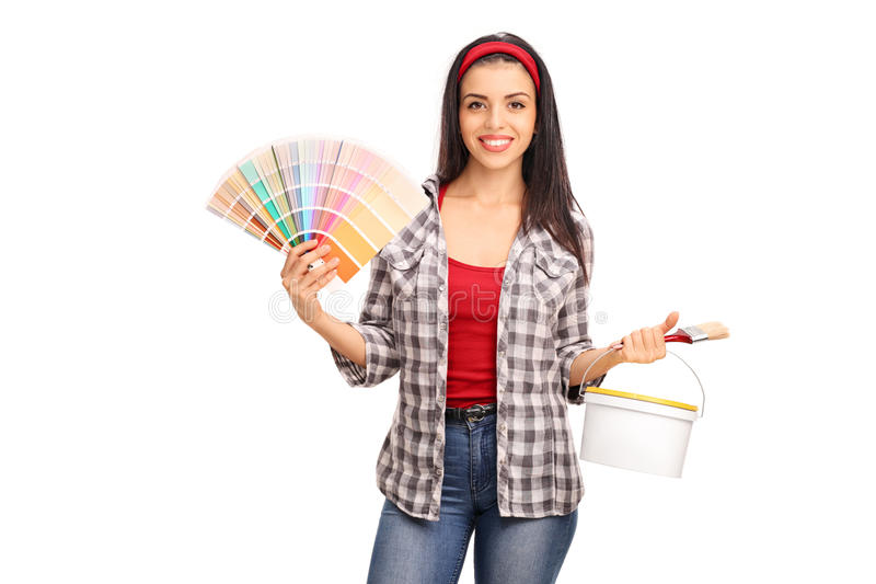 Woman holding a paintbrush and a color swatch stock image