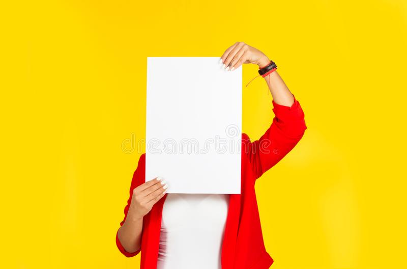 Woman holding a paper on face, instead of her head royalty free stock images
