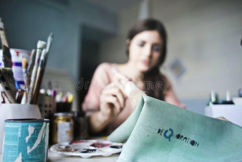 Woman Holding Paper Near Paint Brushes Free Public Domain Cc0 Image