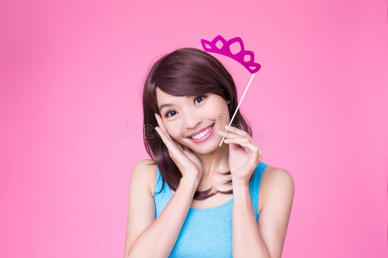 Woman holding paper party sticks. On the pink background royalty free stock photos