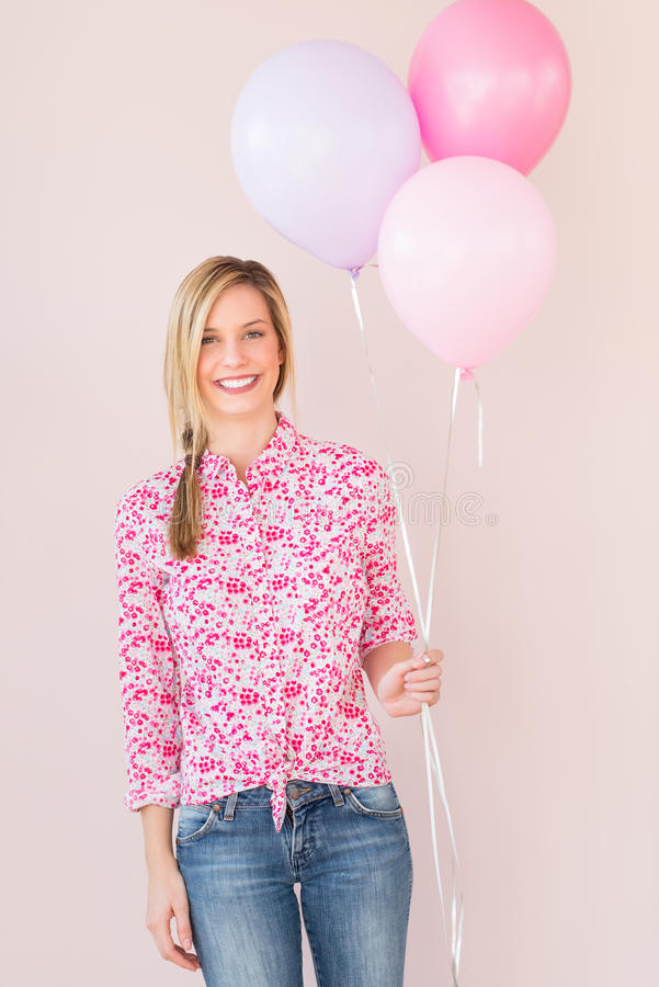 Woman Holding Party Balloons Against Colored Background Royalty Free Stock Image