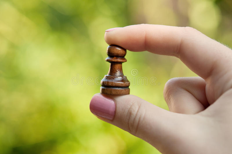 Woman holding a pawn