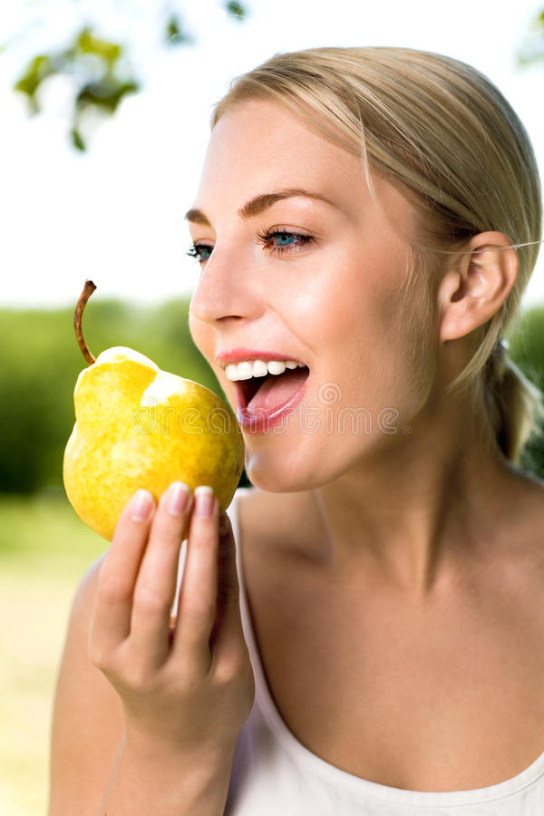 Free Woman Holding Pear Stock Photo - 9637290