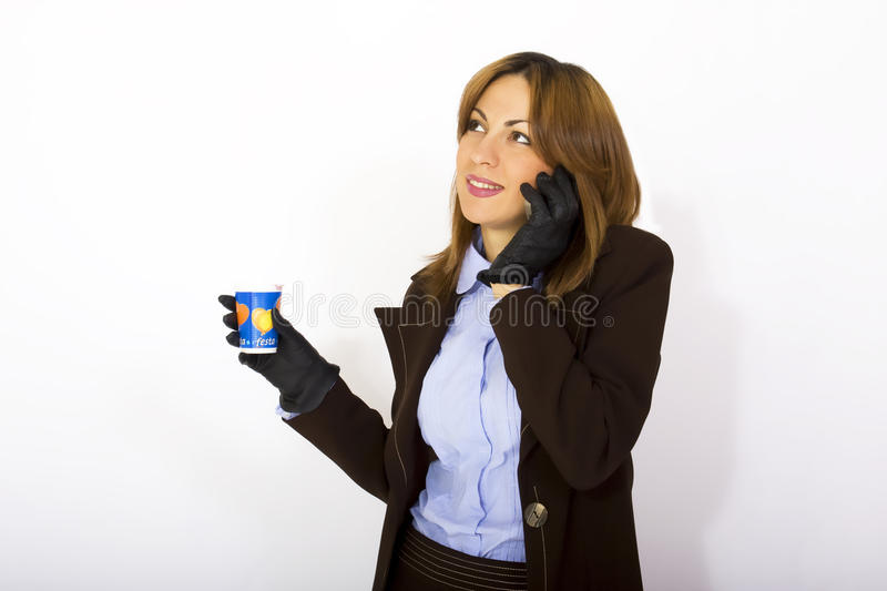 Download Woman Holding Phone And Coffee Stock Photo - Image: 10692566