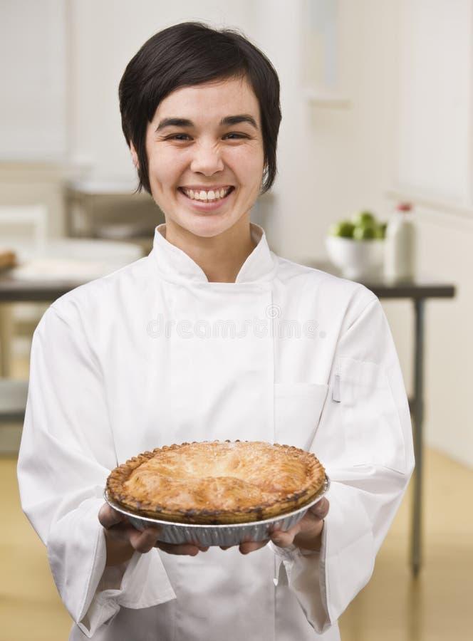 Woman Holding Pie stock photos