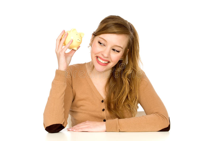 Woman Holding Piggy Bank. Young Woman Holding Piggy Bank stock image