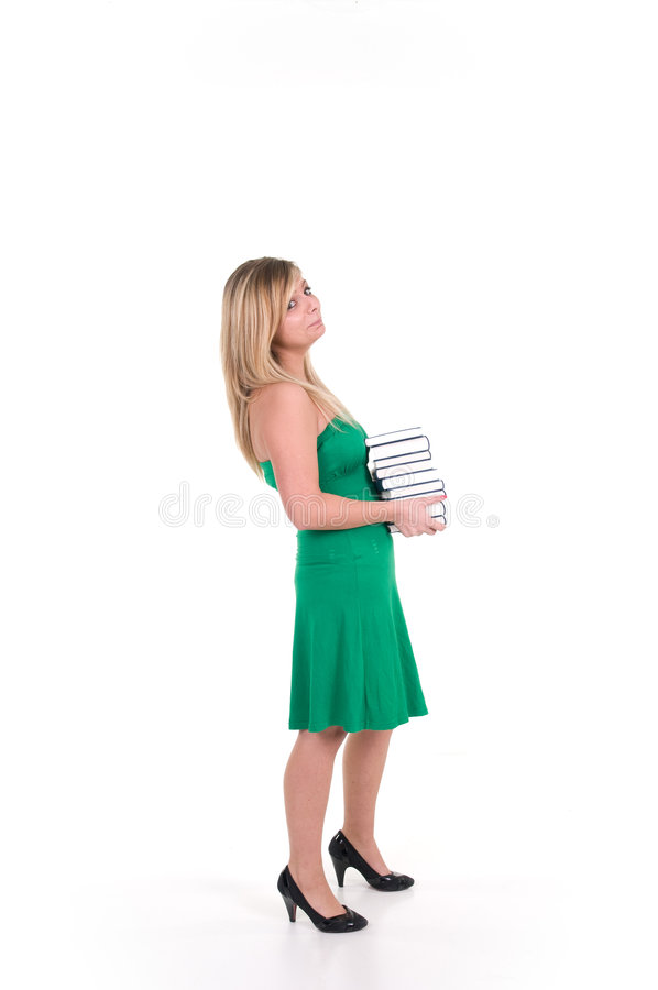 Woman holding pile of books stock images
