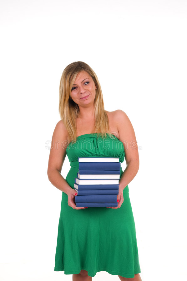 Woman holding pile of books royalty free stock image