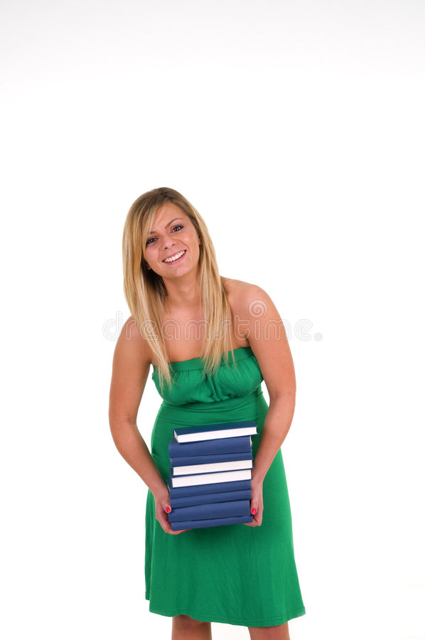 Woman holding pile of books stock photography