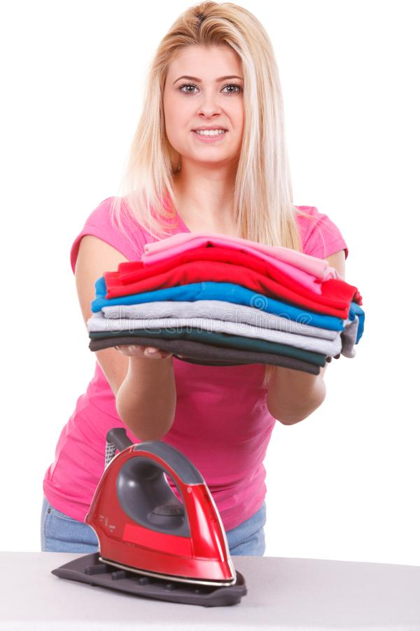Woman holding pile of folded clothes royalty free stock photos