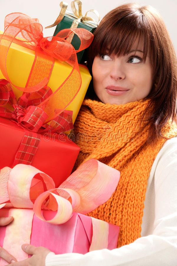Free Woman Holding Pile Of Gifts Stock Photo - 11021420
