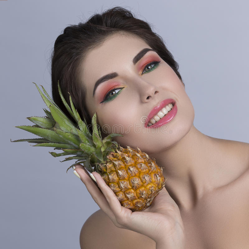 Woman holding pineapple royalty free stock image