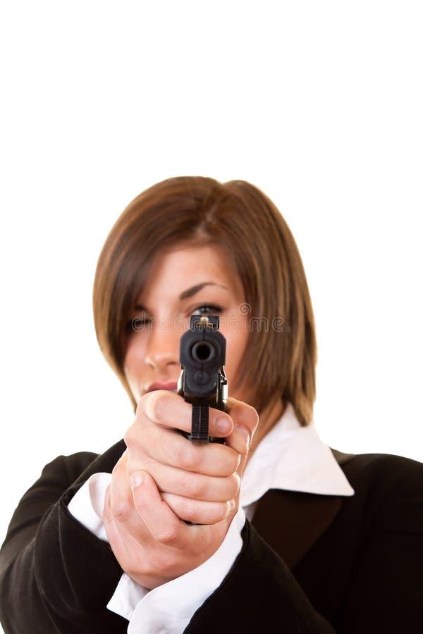 Woman holding a pistol stock photo
