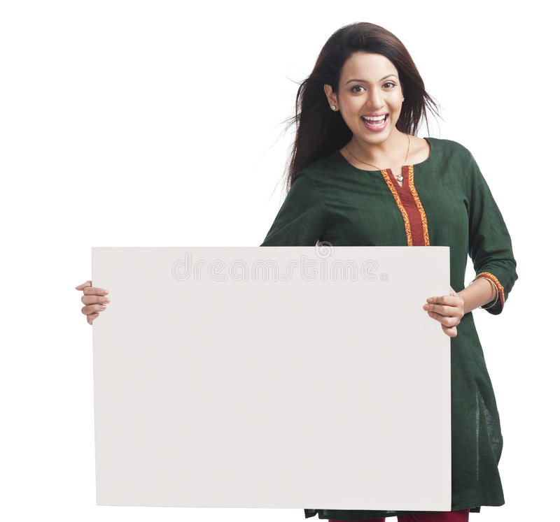 Woman holding placard royalty free stock photo